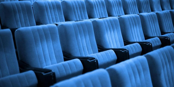 Empty chairs at cinema or theater. Blue tone.